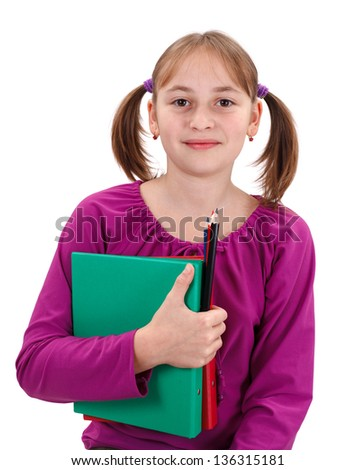 Teenager girl smiling, holding folders and pencils in her hand - stock photo