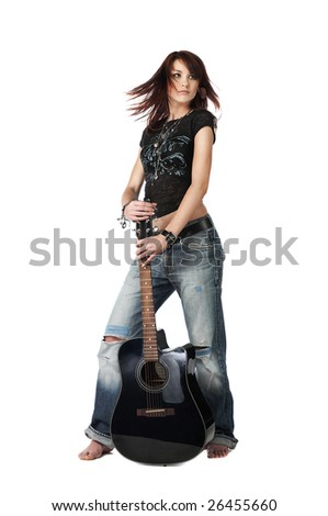 Teenager girl standing with acoustic guitar, isolated on white