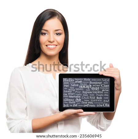 Teenager girl with a tablet computer. Different world languages concept. - stock photo