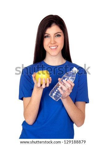 Teenager girl with a yellow apple and water isolated on white background - stock photo