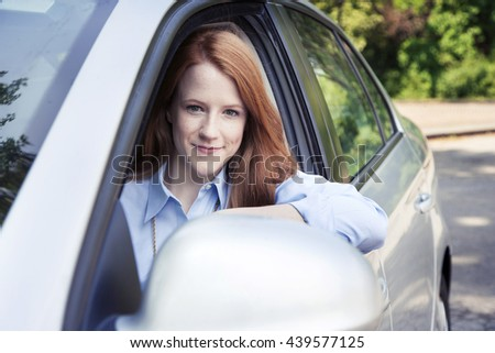 Teenager girl with car - stock photo