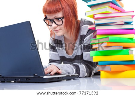 teenager girl with laptop and pile of color books, isolated on white