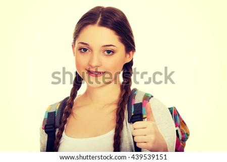 Teenager girl with school backpack. - stock photo