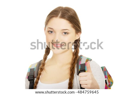 Teenager girl with school backpack.