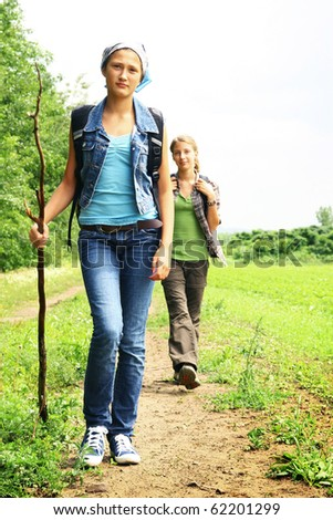 Teenager girls walking into a path in a mountain