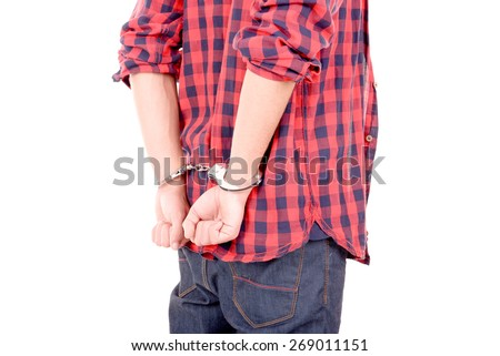 teenager handcuffed isolated in white - stock photo