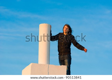 Teenager having reached the top and enjoying the moment, a concept - stock photo
