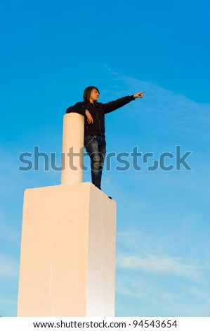 Teenager high up  to see what future is to bring - stock photo