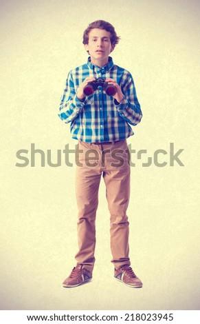 teenager holding a binoculars - stock photo