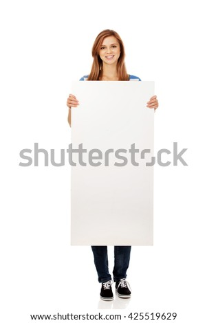 Teenager holding a blank banner - stock photo