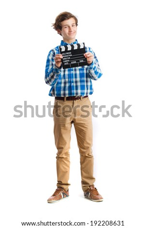 teenager holding a clapboard - stock photo