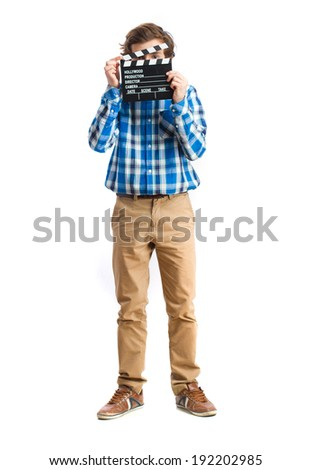 teenager holding a clapperboard - stock photo