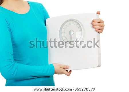 Teenager holding a scale. - stock photo