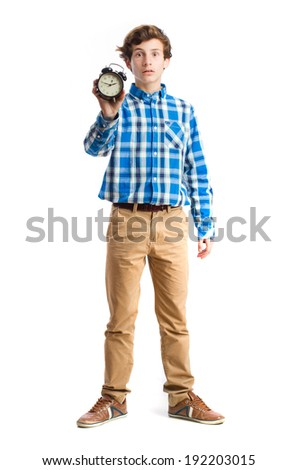 teenager holding an alarm clock - stock photo