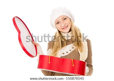 teenager holding heart shaped box isolated on white background - stock photo