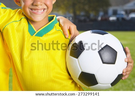 teenager holding soccer ball