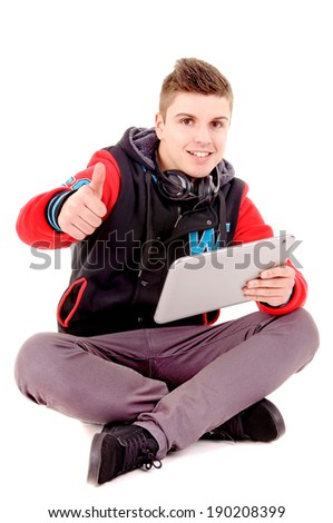 teenager holding tablet isolated in white