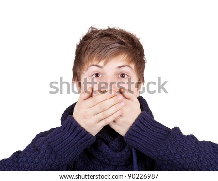 Teenager in a purple sweater shut his mouth with his hands - stock photo