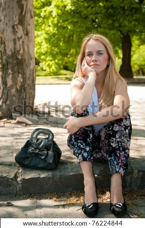 Teenager in depression outdoors - stock photo