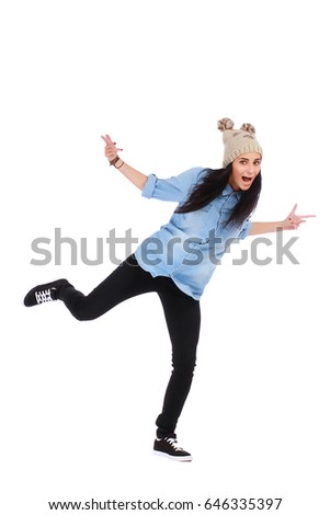 teenager in jeans dancing street dance on white