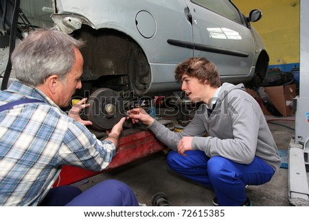 Teenager in professional training in workshop - stock photo