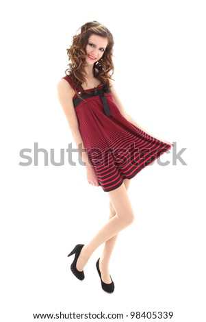 teenager in red dress posing over white background - stock photo
