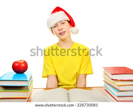 Teenager in Santa Hat on the School Desk Isolated on the White Background - stock photo