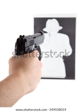 Teenager in the hood with gun. - stock photo