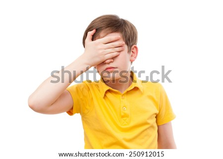 Teenager in yellow t-shirt shuts his eyes by hand - stock photo