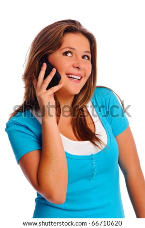 Teenager is happy while talking on her cell phone - stock photo