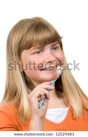 Teenager is ready to clean her teeth with braces - stock photo