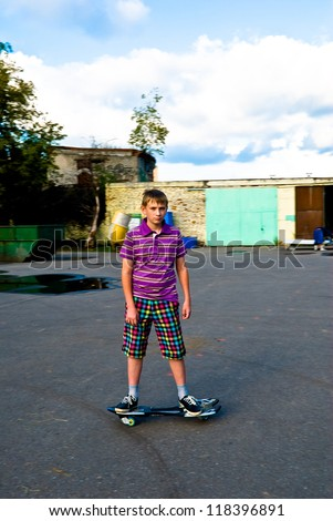 Teenager is riding a waveboard - stock photo