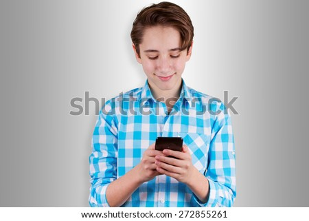 Teenager is typing  message in phone - stock photo