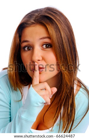 Teenager isolated in studio puts her finger to her lips