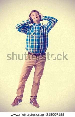 teenager listening music with headphones - stock photo