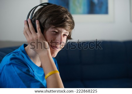 Teenager listening to music on his headphones.