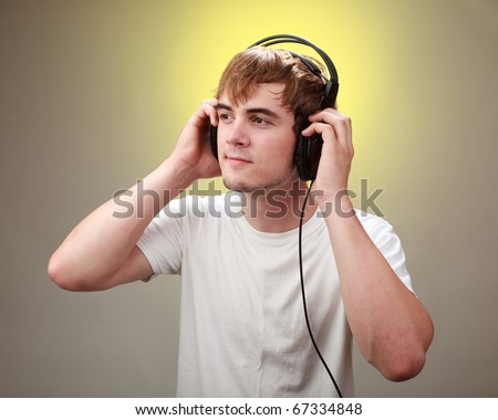 Teenager listening to music with Headphones - stock photo