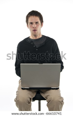 teenager looking confused sitting on stool on white background - stock photo