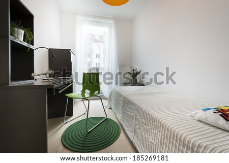 Teenager modern room with green chair and carpet - stock photo
