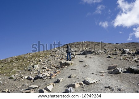 teenager on a footpath uphill - stock photo