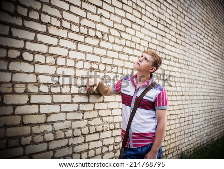 teenager on background wall - stock photo