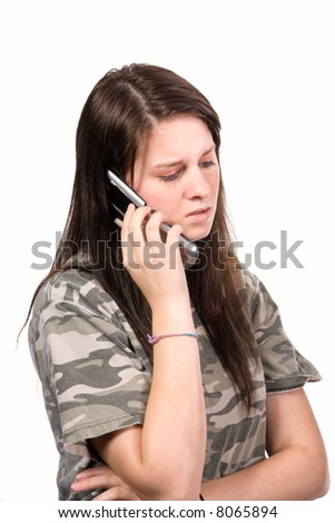 Teenager on cell phone isolated over white showing concern, regret, unhappiness - stock photo