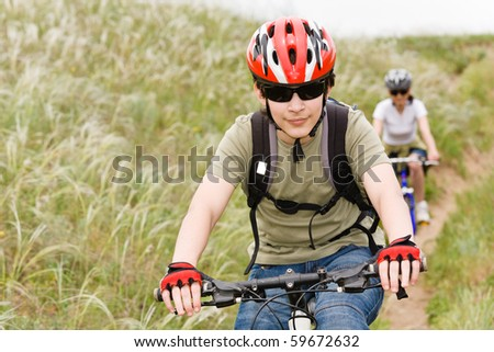 teenager on the mountain bike - stock photo