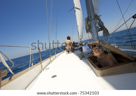 teenager on the sail boat - stock photo