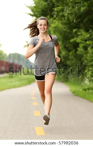 Teenager out for a jog - stock photo