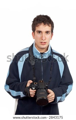 Teenager photographer holding a camera over a white background - stock photo