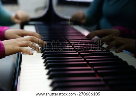 Teenager playing a piano, close-up on hands and keyboard. Rehearsal, school and discipline concept.  - stock photo
