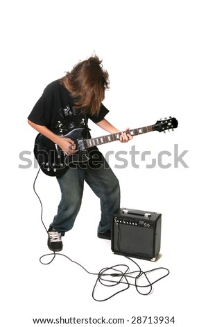 Teenager Playing Electric Guitar With Amplifier on White Background - stock photo