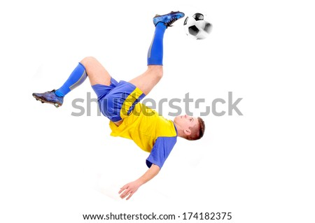 teenager playing soccer isolated in white - stock photo