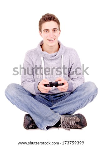 teenager playing videogames isolated in white - stock photo